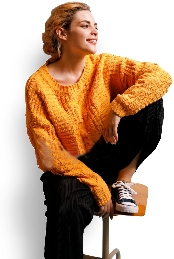 smiling woman sitting on a stool